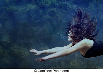 Beauty underwater - Beautiful lady swimming and diving...
