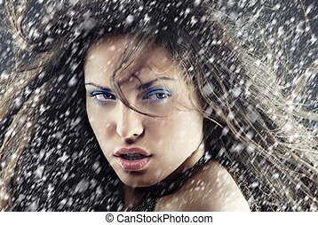 Xmas snow - Sexy woman outdoors under the heavy snow in...