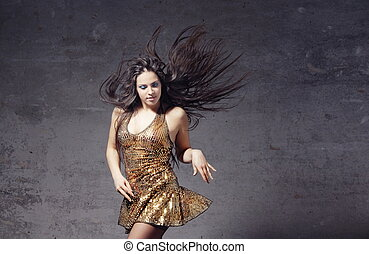 Dancer in the trashy room - Active woman with long hair...
