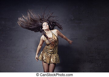 Disco dancer with long hairs - Woman dancing and moving her...