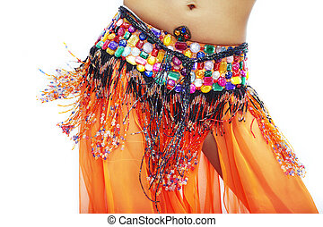 Orange motion - Body part of belly dancer in traditional...