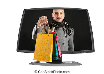 young man with paper bags in a computer monitor