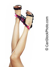 Legs and lingerie - Woman legs on a white background with...