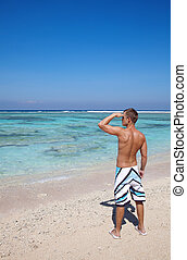 Looking into distance - Young man looking into distance on a...