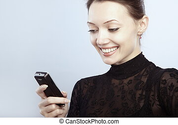 SMS - Smiling lady reading or sending SMS