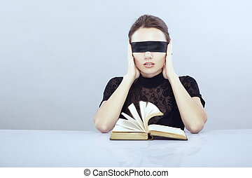 Audio book - Lady with blindfold hearing the book pages.