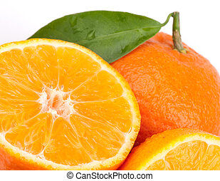 Tangerines with green leaves isolated on white.