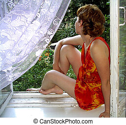 A girl sitting on the windowsill