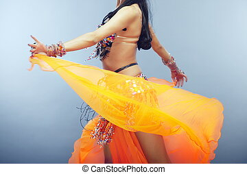 Belly dancing - Body part of the woman dancing belly dance...