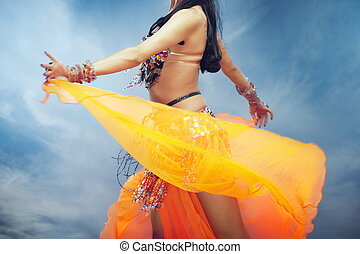 Belly dance outdoors - Lady dancing belly dance outdoors in...