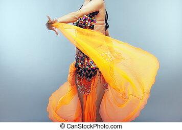 Motion of dancer - Dancing belly dancer moving her...