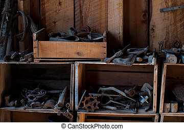 Blacksmith Tools - Blacksmith tools in old barn. Museum of...