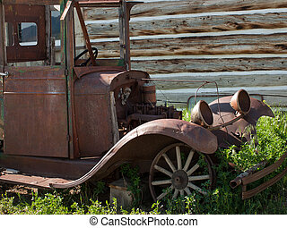 Rusted Truck - An old rusted Ford truck sits on a farm....