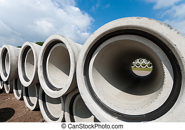 concrete drainage pipes - stacked concrete drainage pipes on...