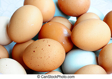Eggs - Dozens of fresh eggs in a pile