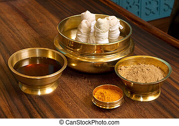 herbs powder and oil in bronze cups - herbs powder and oil...