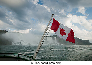 Canadian flag and Niagara Falls - The Canadian flag flaps...