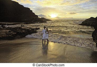 newlywed couple at sunrise