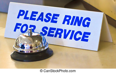 Please ring for service sign and silver push button bell...