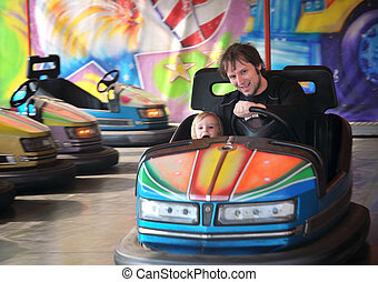 The cars - The fairground attractions at amusement park .