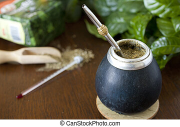 yerba mate gourd and a bombilla - serving yerba mate gourd...