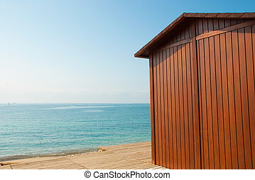 Beach hut - A wooden beach hut on a sunny Mediterranean day