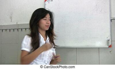 Thai Lady Teaching An English Class - A Thai lady teaching...