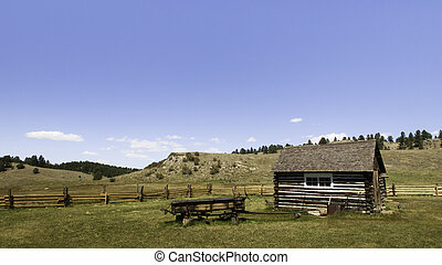 Rustic log cabin on the farm - Old homestead buildings on...