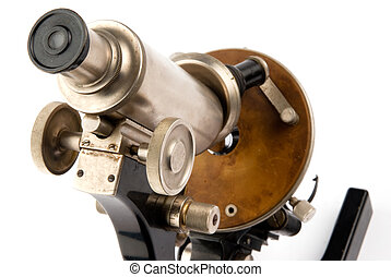 Old microscope closeup - closeup old microscope on white...