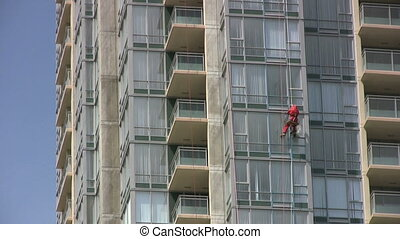 Window Washer in Red Suit - A window washer in a red suit...