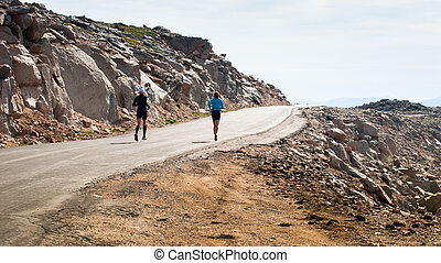 Runners - Two runners on the mountain road
