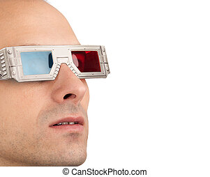 Young man watching television in 3D wearing red and blue...