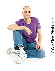casual young man sitting relaxed - casual young satisfied...