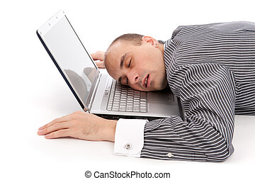 businessman sleeping on laptop - young businessman sleeping...