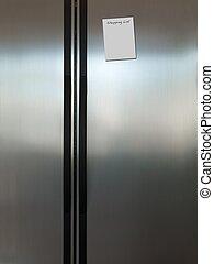 Fridge - A modern duel stainless steel kitchen fridge