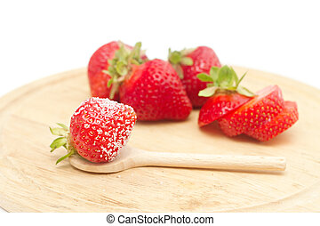 strawberries on a board isolated on white
