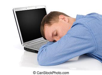 Man sleeping on a laptop