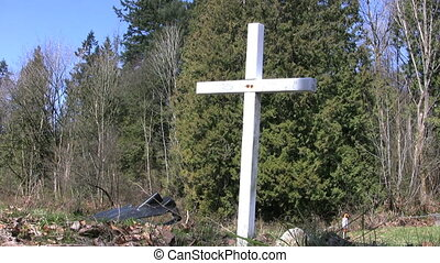 White Cross - A white cross stands by the side of the road...