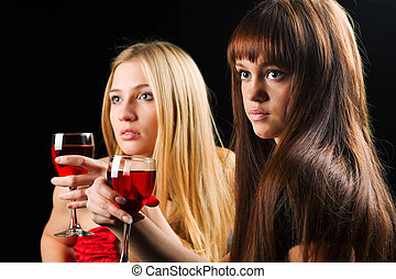 Two young women in a night bar - Two young women drinking...