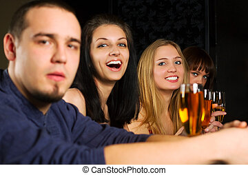 Young people relaxing in a bar - Young people drinking white...