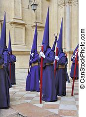 Semana Santa in Malaga - Processions of Nazarenos leaving...