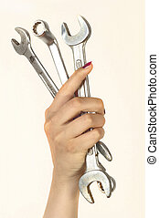 woman holding big chrome vanadium spanners in the hand