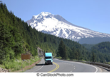 Mt. Hood & transportation. - A truck descending from the mt....