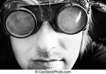 Young survivor of the apocalypse in goggles with light