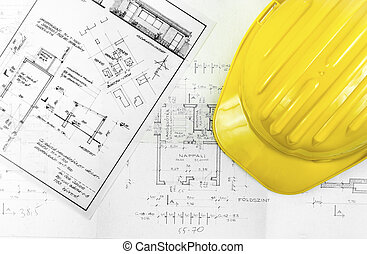 Construction plans with tools of a worker