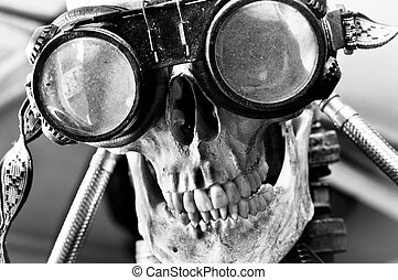 Human skull with insane look and goggles robot