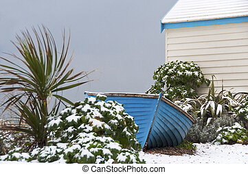 Blue fisherman boat in winter - Blue fisherman small boat on...