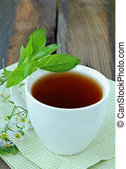 Cup of  tea with herbs, mint