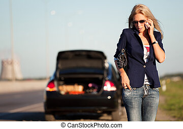 Woman calling for help - Young blond with a broken car...