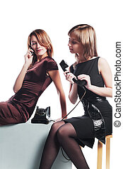 Telephone lines - Two young women with a retro and modern...